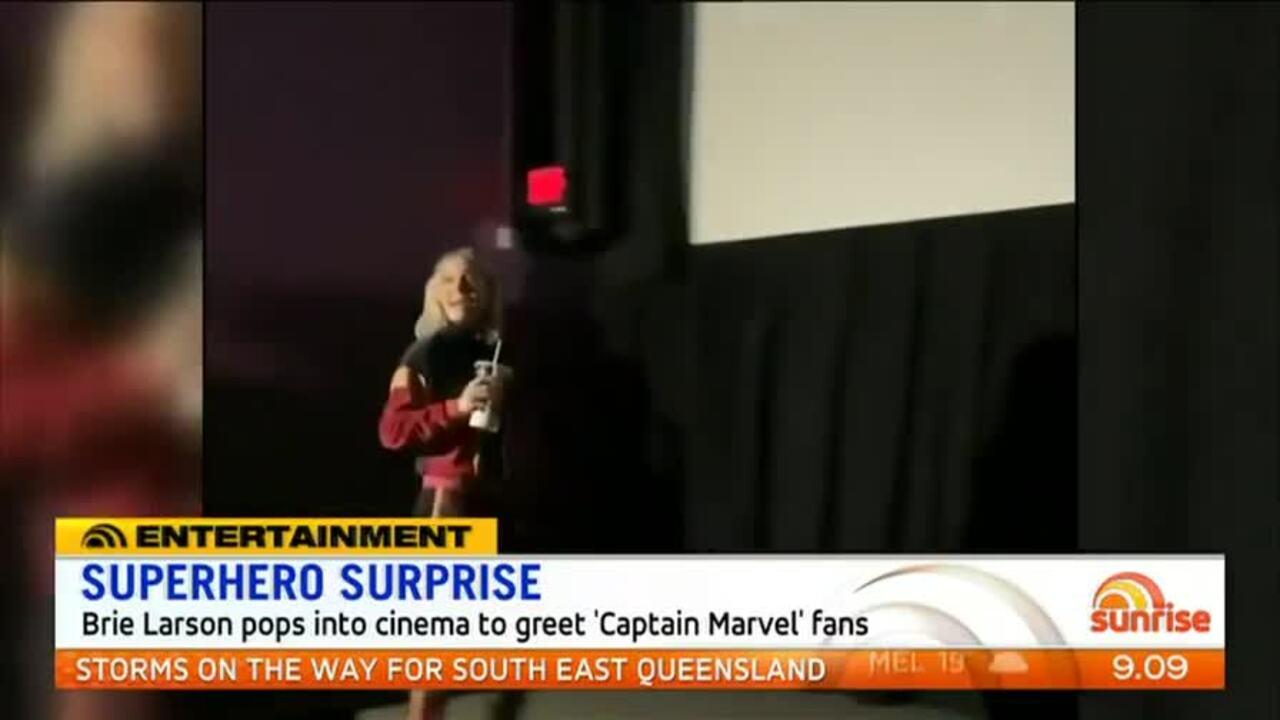 Brie Larson pops into cinema to greet 'Captain Marvel' fans.