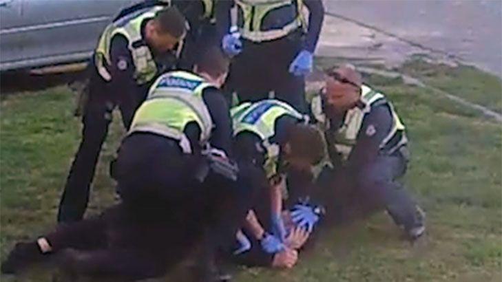 Watch police detaining John  Warning: violence