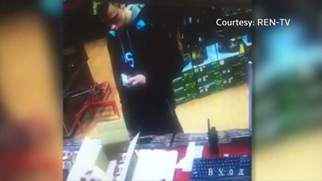 Crimean gunman seen buying shotgun shells on CCTV