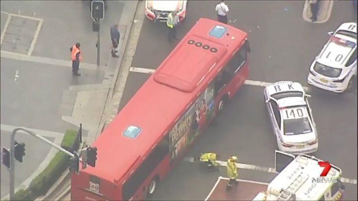 Woman dies after being hit by bus