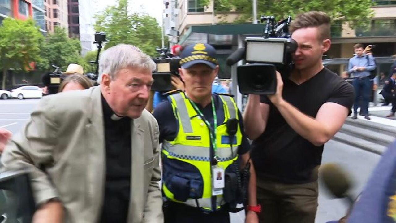 Cardinal George Pell arrives at court