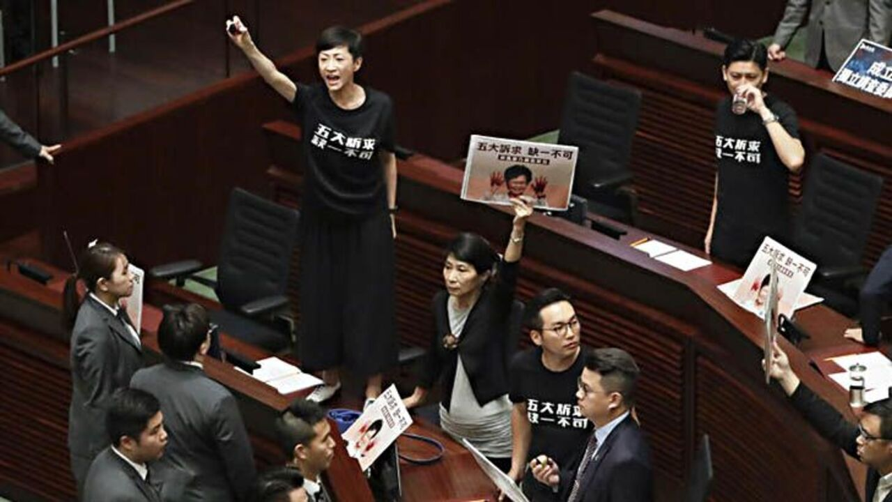 Carrie Lam heckled during policy address