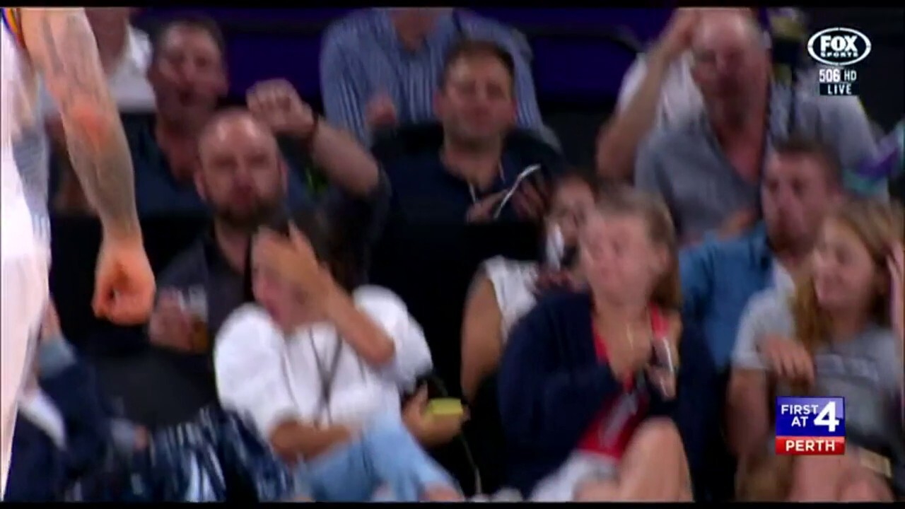 A Melbourne United fan wasn't paying attention when the ball when hurled her way.