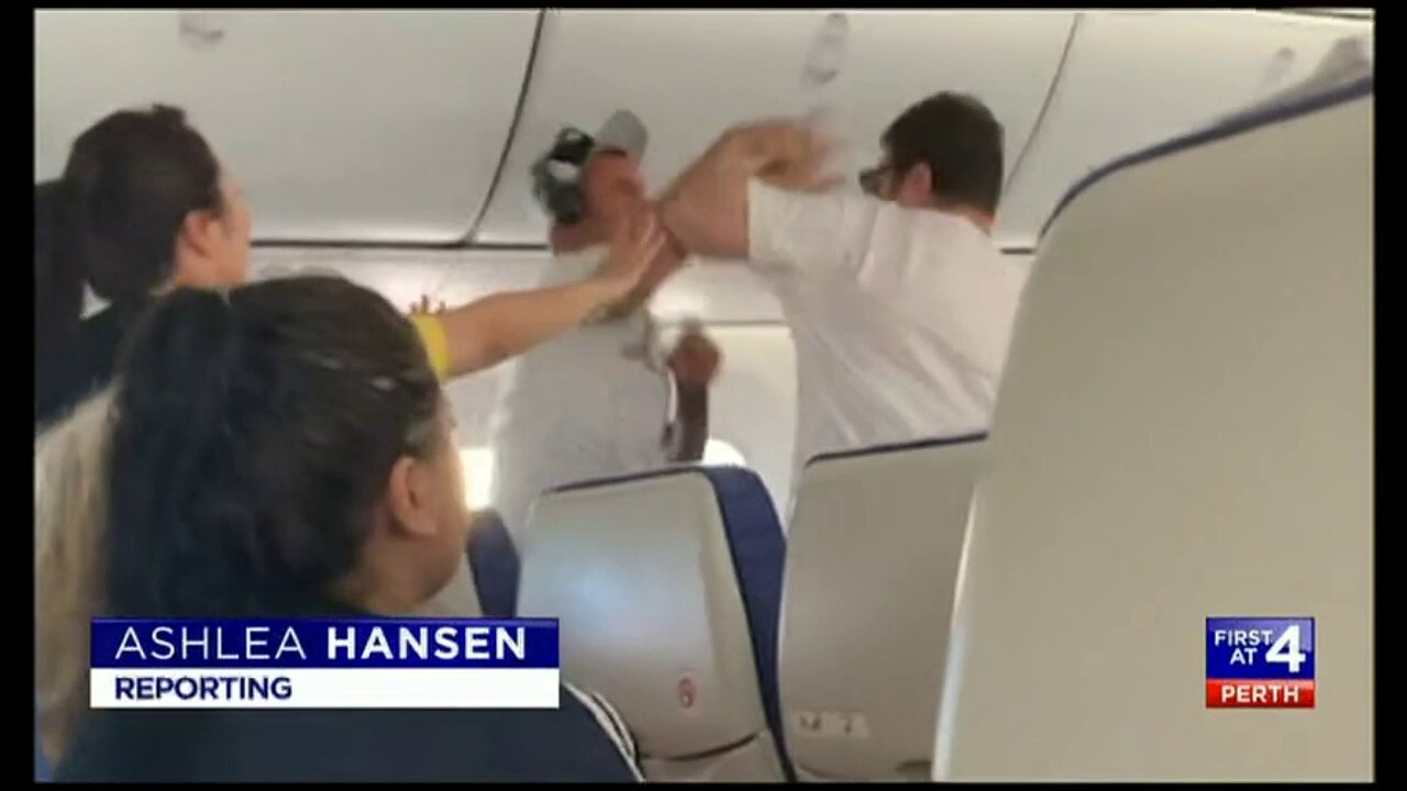 On board passengers had to help restrain a man who became violent on a flight to Singapore.