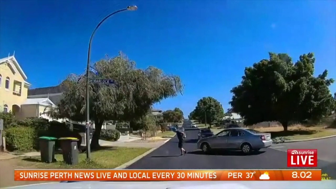 Video shows the moment a Churchlands Senior High School student was thrown over the bonnet of a car but somehow managed to stand up and walk to the verge