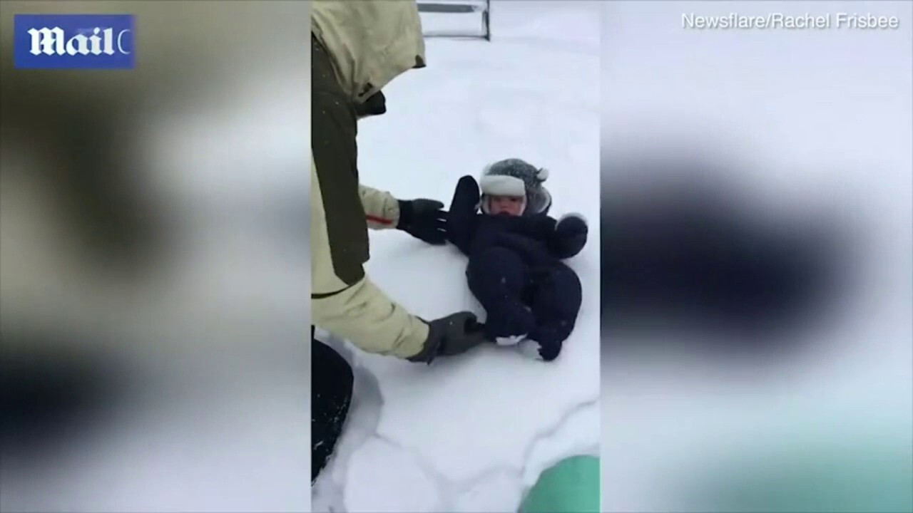 A baby became submerged in snow after his father decided it would be fun to gently throw him into the snow