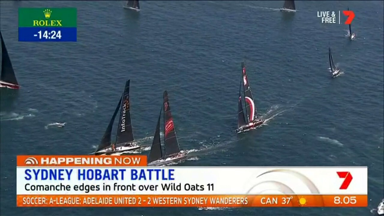 Supermaxis Wild Oats and Comanche are neck and neck, leading the fleet in the Sydney Hobart