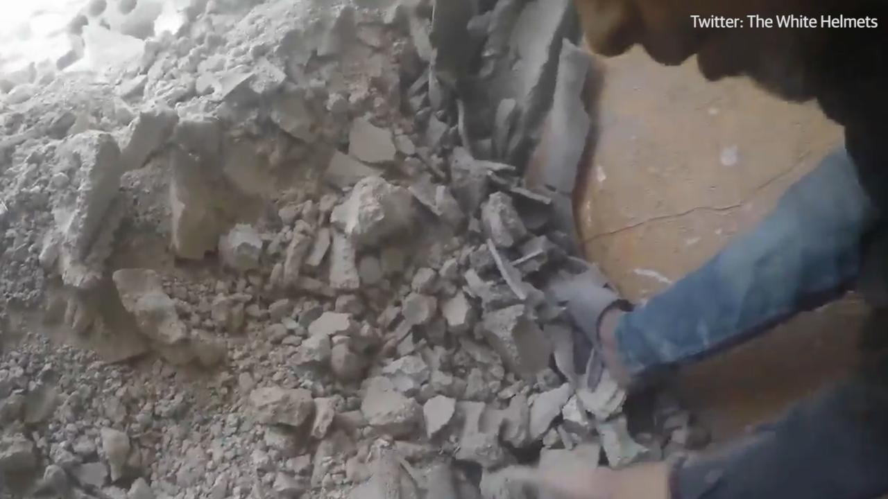Incredibly, this young girl was pulled alive from rubble in the Syrian city of Douma, after intense aerial bombardments. WARNING: DISTRESSING CONTENT