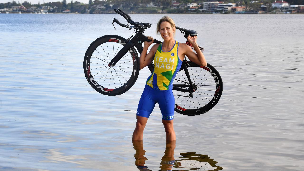 Emily Loughnan victorious in the 25 to 29-year-old female category at the annual Ironman World Championship in Kona, Hawaii.