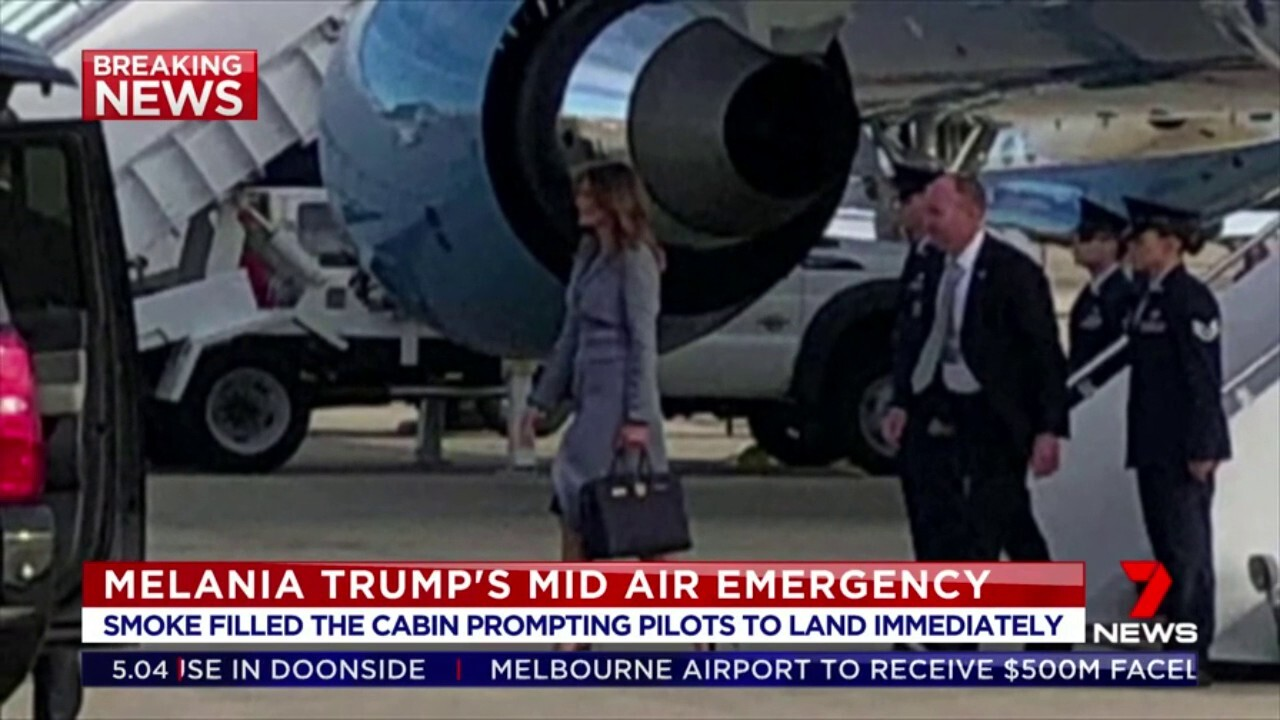 The plane carrying the US First Lady was forced to turn back and land in Washington after smoke filled the cabin