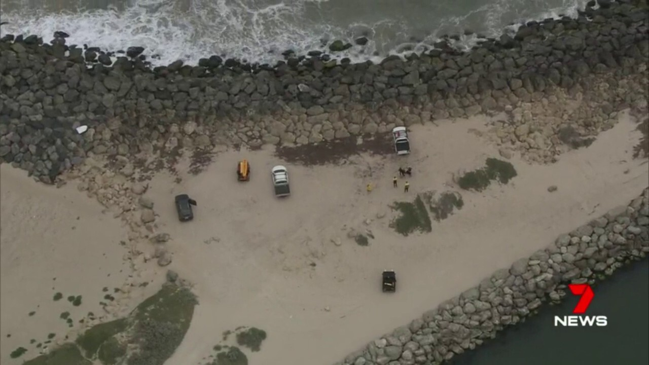 Swimmers, including children, have been forced to flee the water in Mandurah after a man was attacked by a shark.