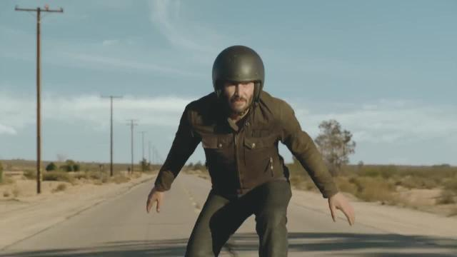 The actor performs motorcycle stunts while preaching self affirmation.