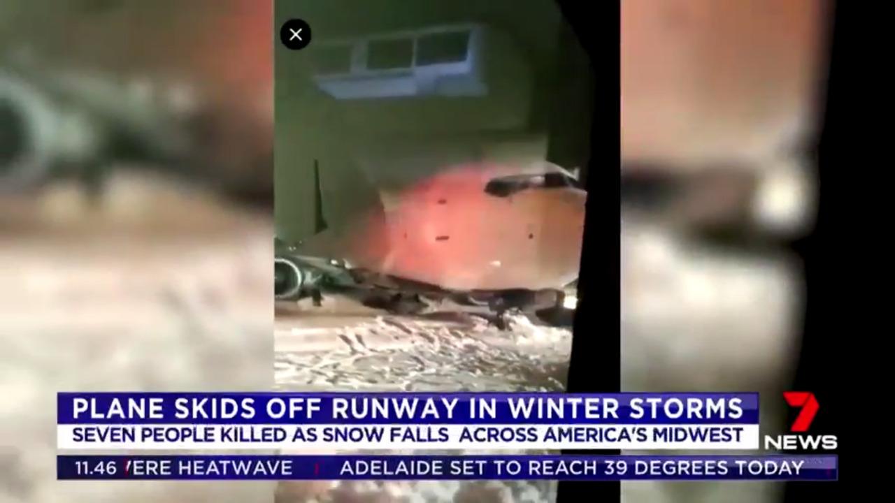 A Delta plane skidded off the runway as it came into land in heavy snow in Cincinnati