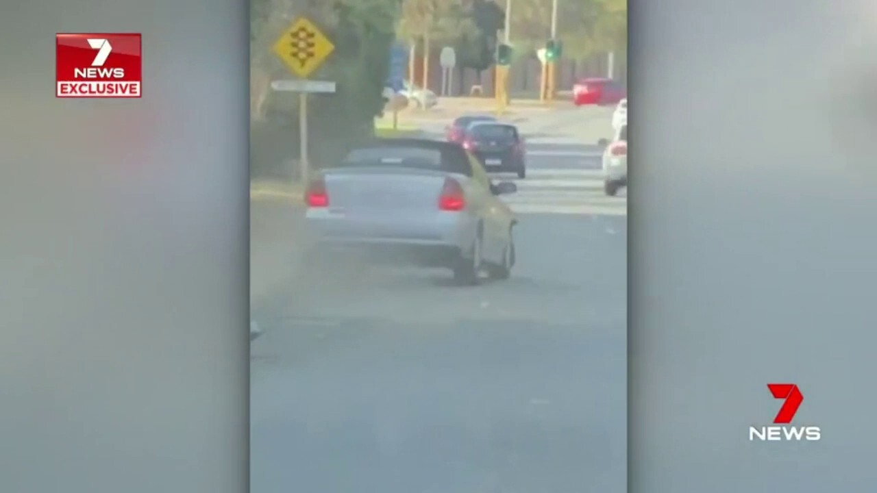 A bizarre and destructive traffic accident has been caught on camera.