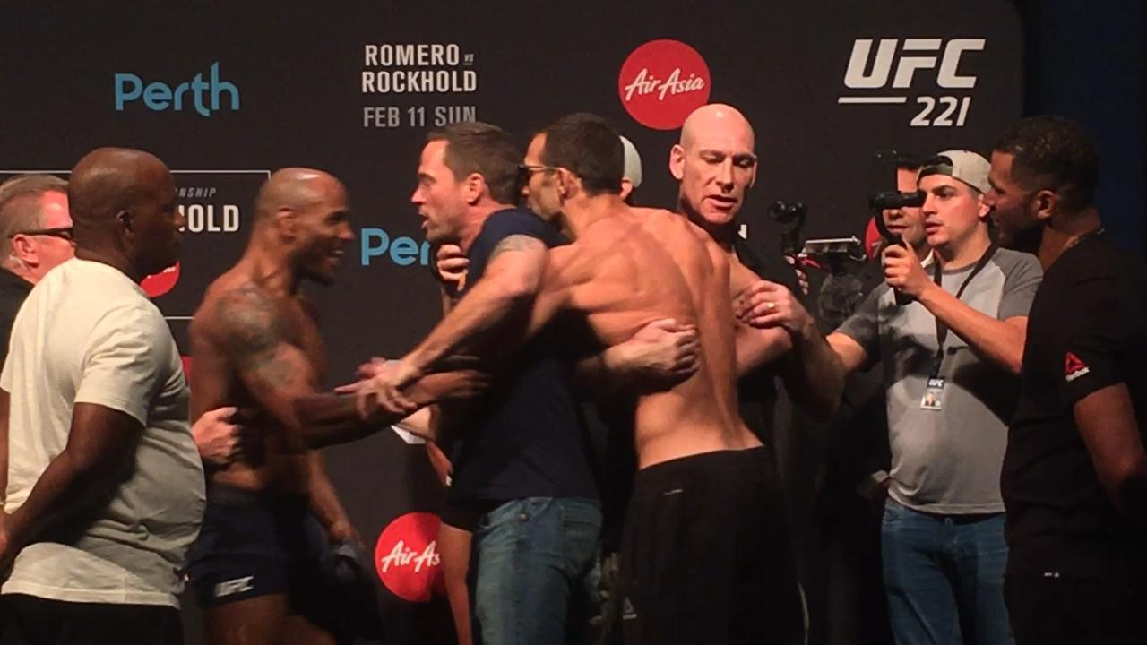 WATCH: Luke Rockhold and Yoel Romero almost came to blows at the weigh-ins after Romero failed to make weight ahead of UFC 221