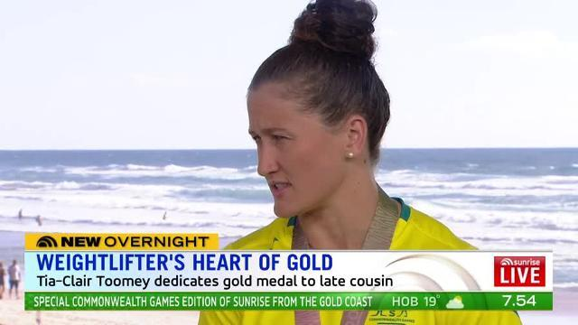 The Aussie weightlifter dedicates her win to her late 17-year-old cousin, killed in a horror car crash last week.