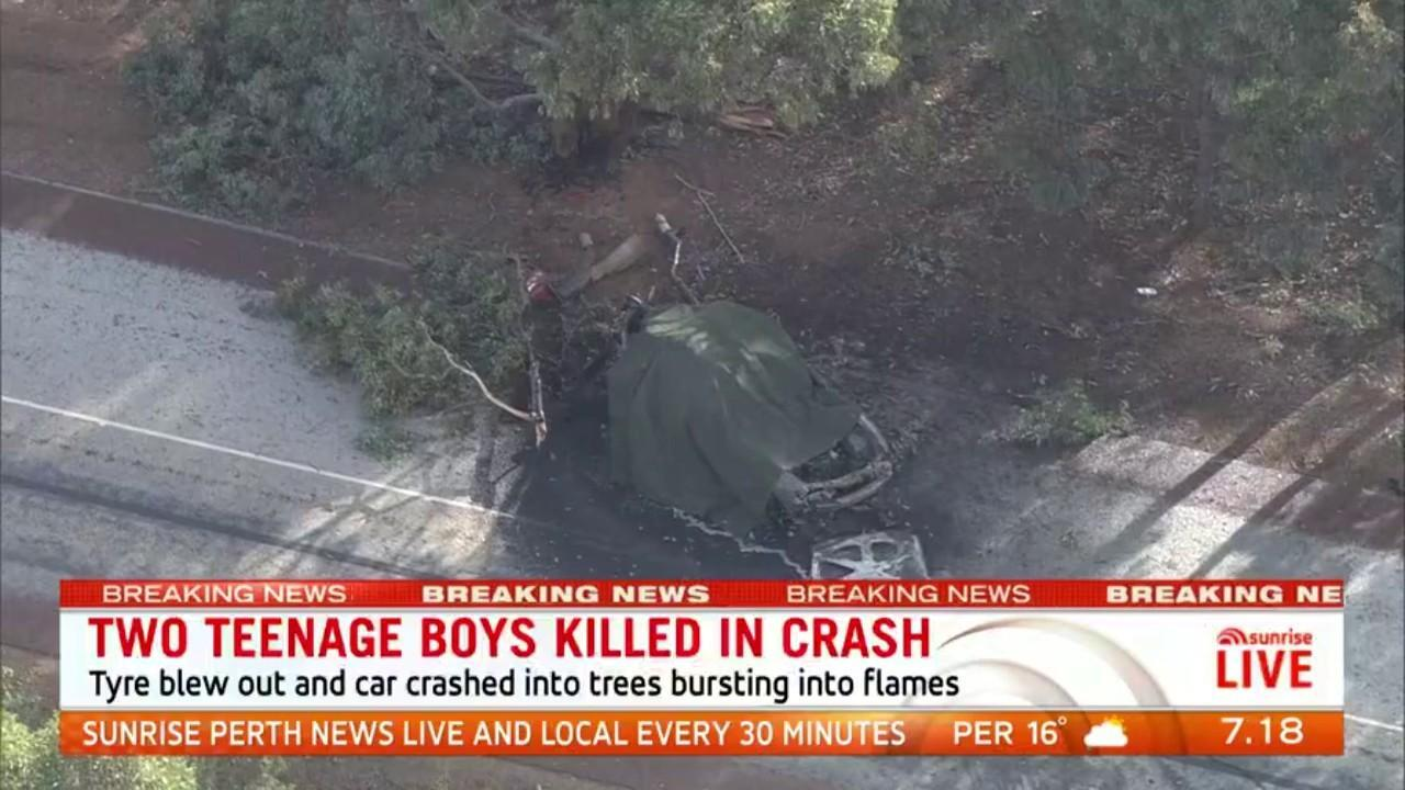 Officers say a tyre blew out and the car crashed into trees before bursting into flames