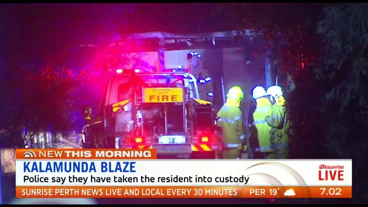 A woman is in custody after her Kalamunda home caught fire on Thursday night