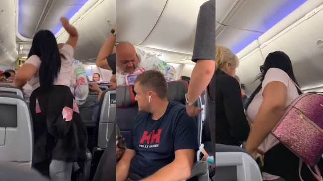 Image result for woman beats man in plane miami