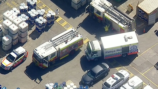 Two men trapped after falling into a tank in Sydney workplace incident