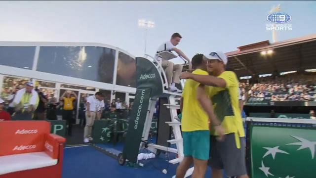 Hewitt embraces de Minaur after Davis Cup win