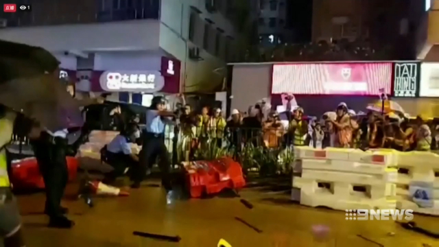 Hong Kong police fire live bullet for the first time
