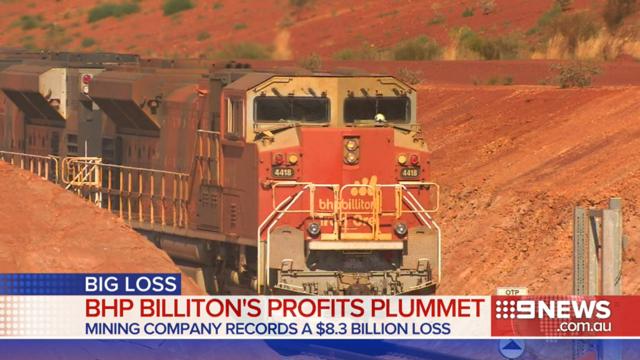 BHP Billiton records historically large profit loss