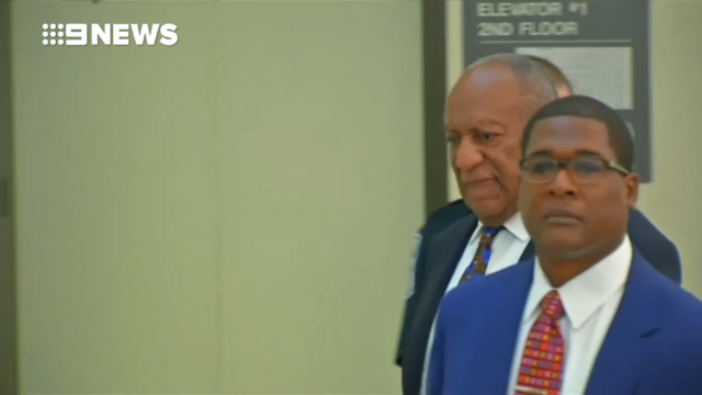 Bill Cosby laughs before going into custody