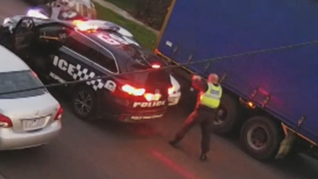 Police forced to shoot at dangerous driver after police car